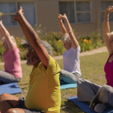 Elders in stretching while in a yoga class