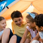 kids playing in a tent