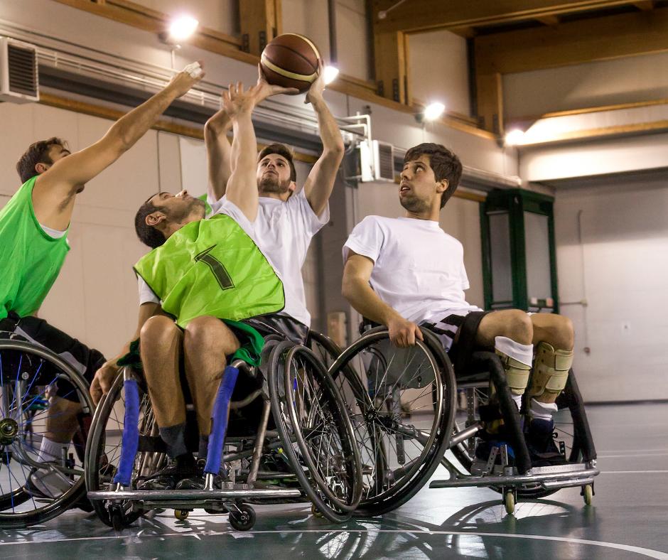 Four guys playing wheelchair basketball