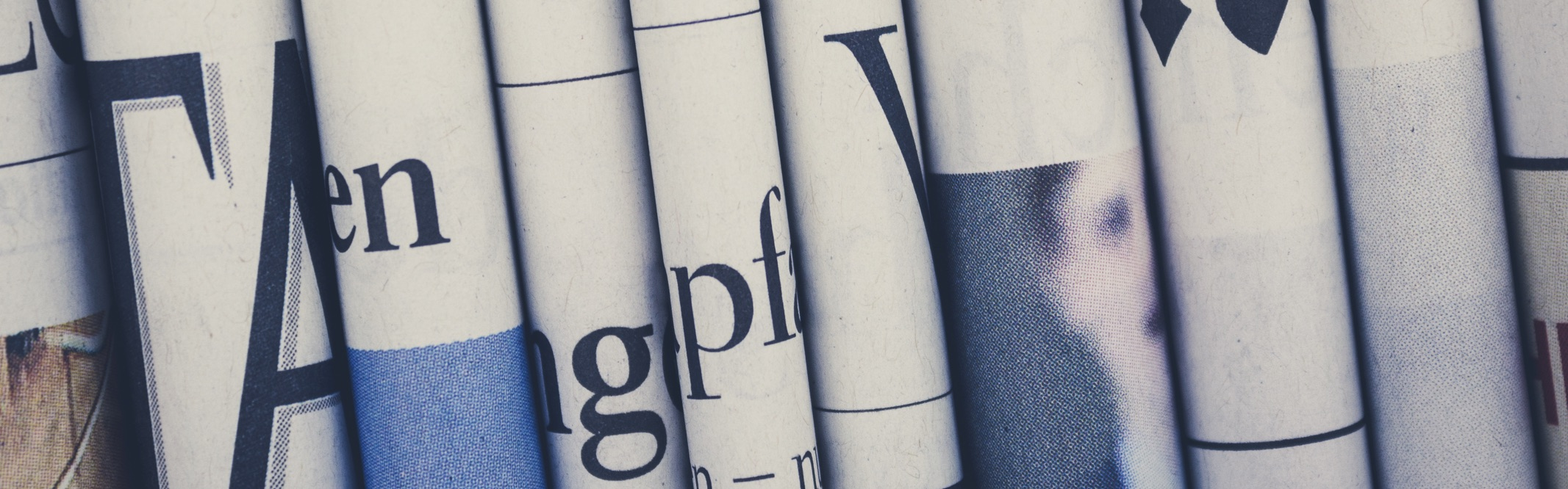 Close up view of vertically stacked newspapers