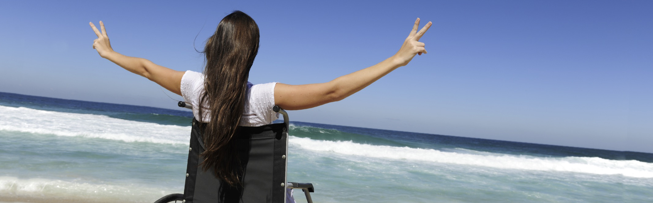 Lady in wheelchair looking out at the ocean